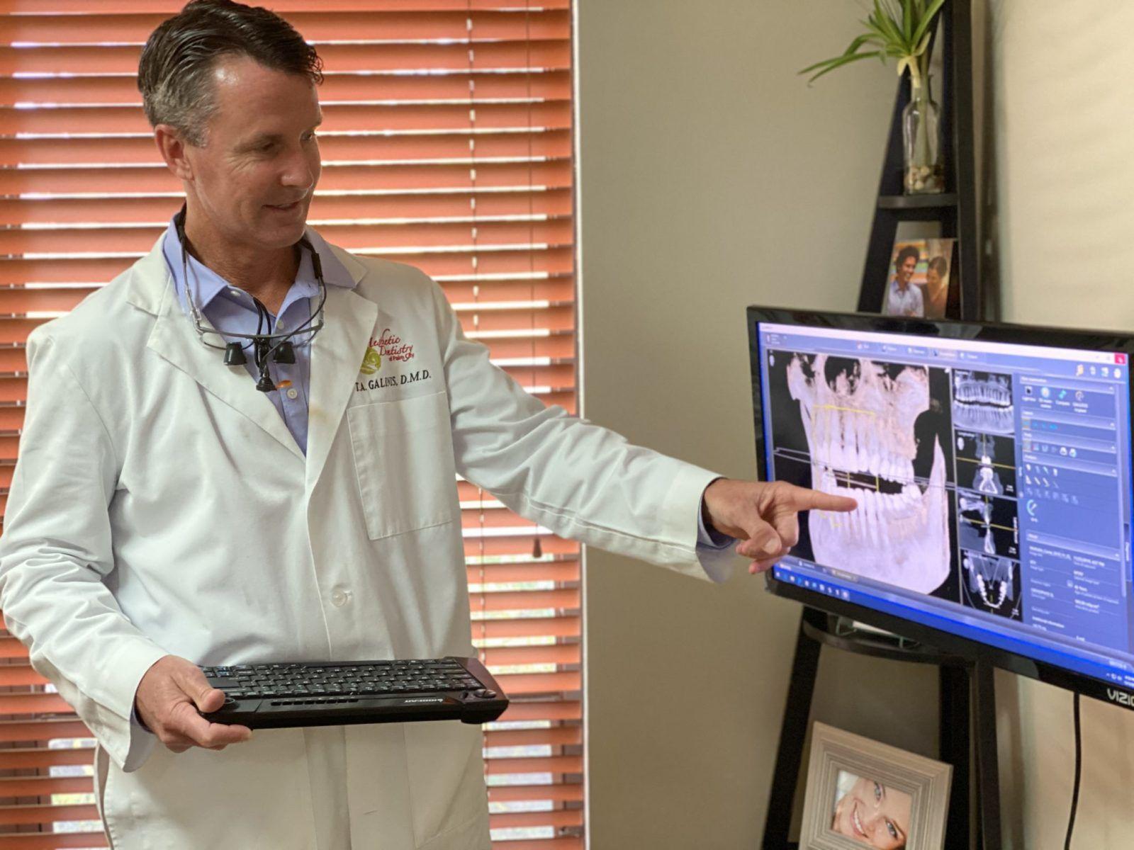 Dr. Tom Galinis explaining dental treatment