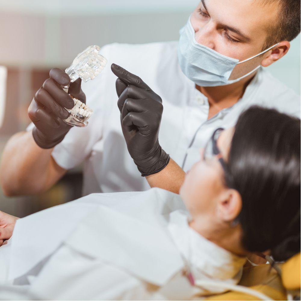 Doctor explaining dental treatment to patient